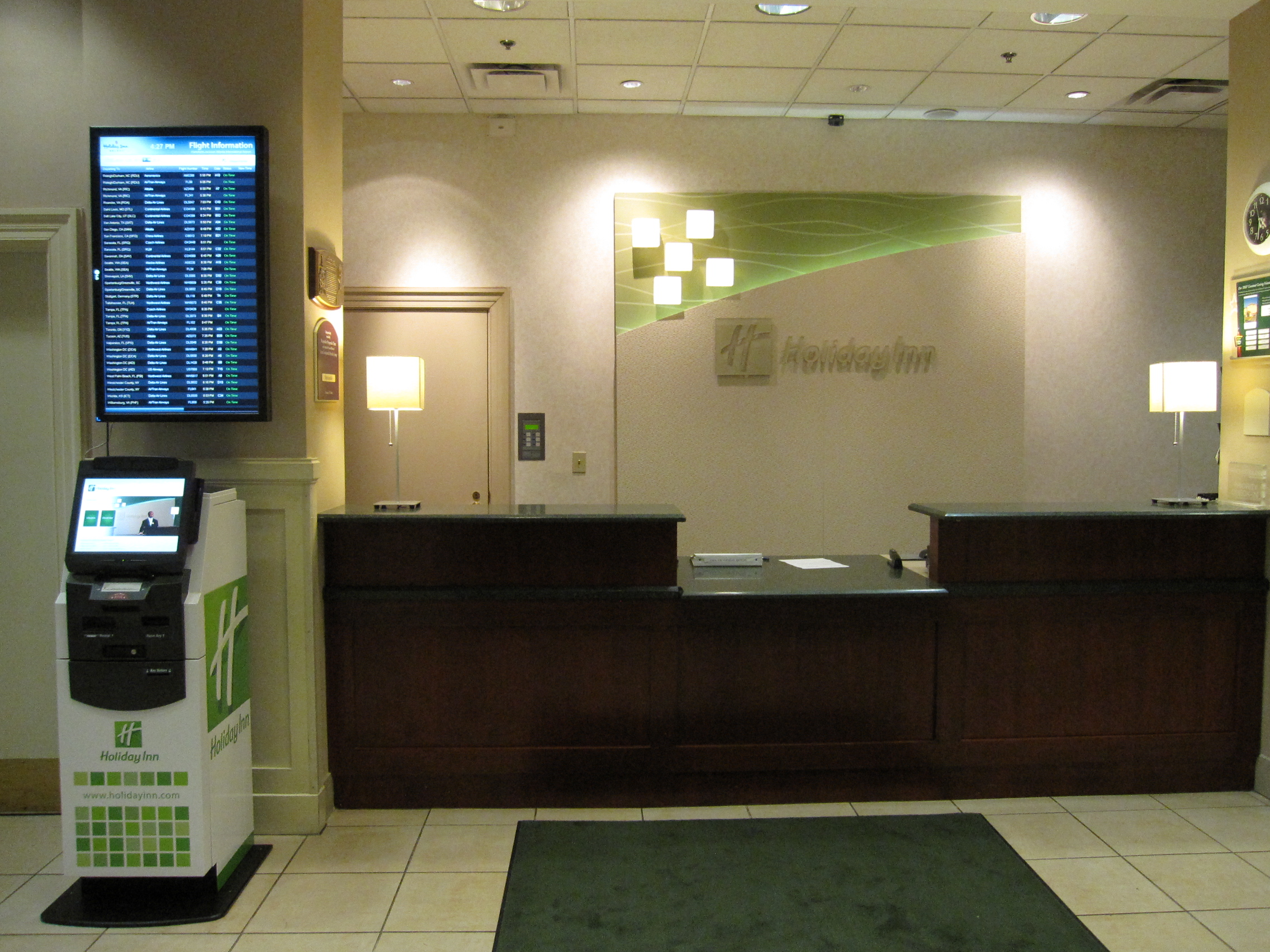 Kiosk in Holiday Inn Lobby with FlightBoard